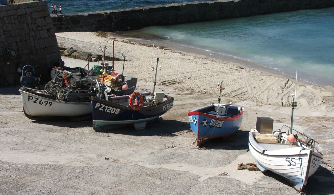 Sennen Cove harbour with boats