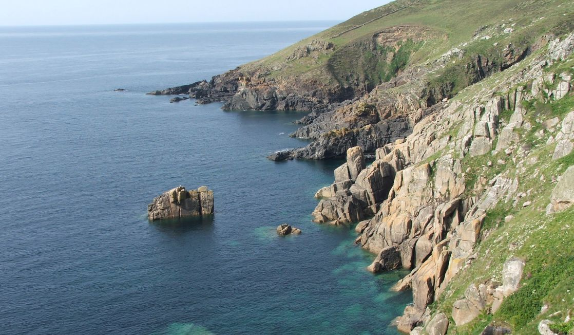 Granite cliffs and calm seas
