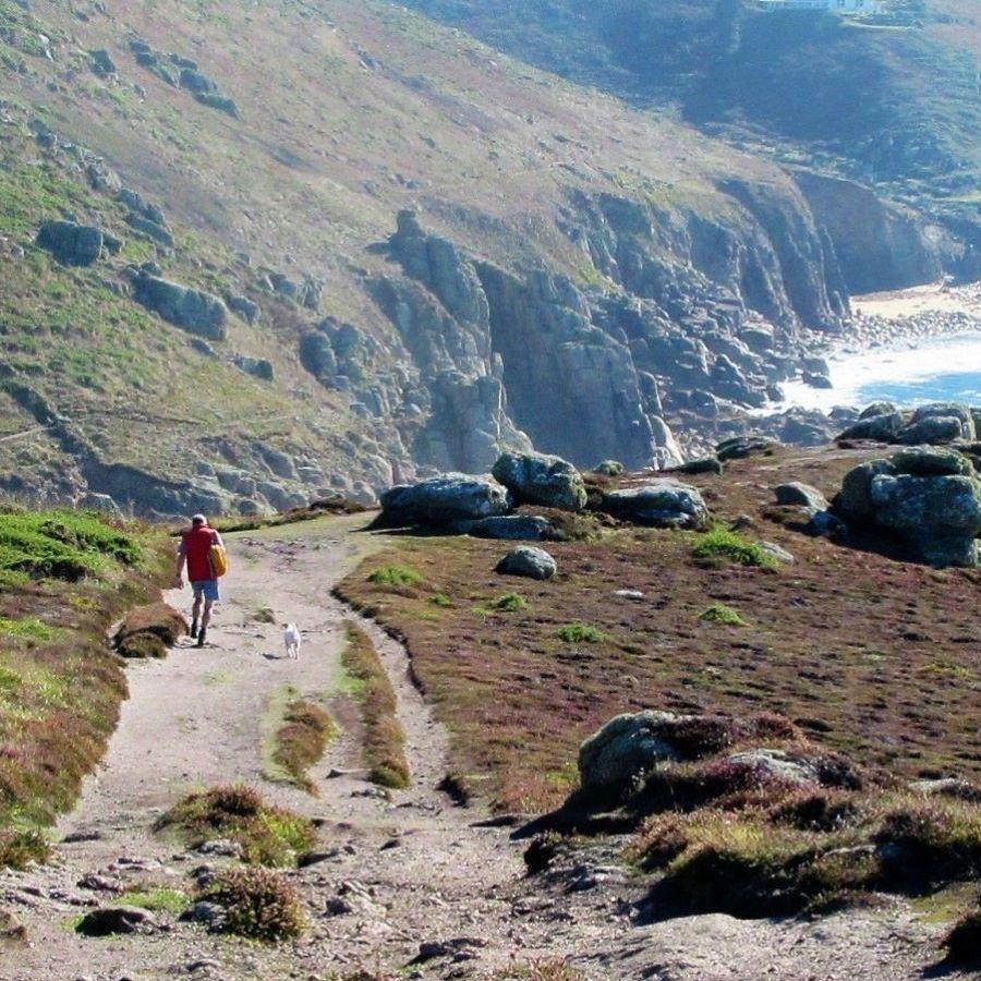 walker at Nanjizal, Cornwall