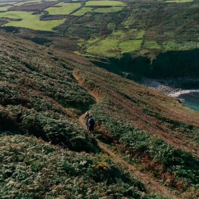 Walkers on the coast path in Cornwall