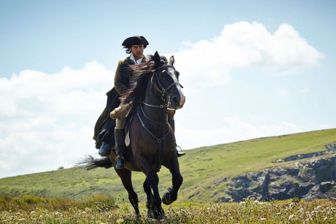 Ross Poldark galloping across the cliffs
