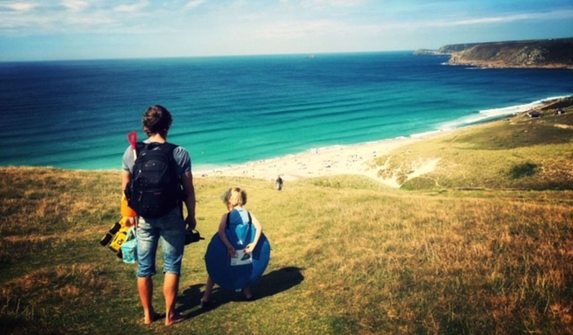 Family on cliffs at Sennen, Cornwall