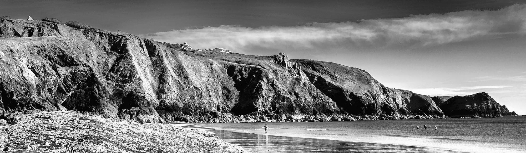 grey cliffs and beach
