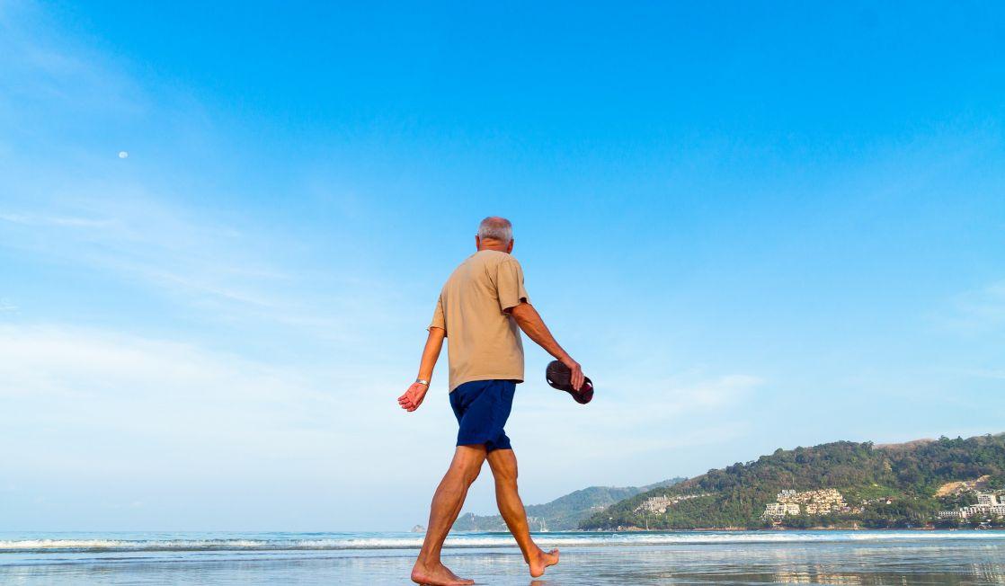 man strolling on a beach