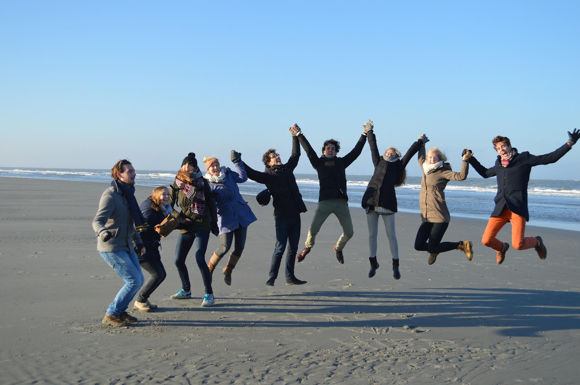 group jump on the beach