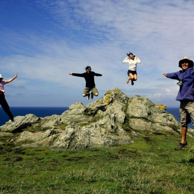 Family jumping at Land's End