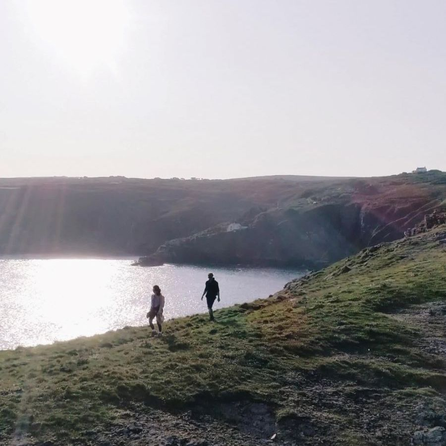 two walkers on the coast path